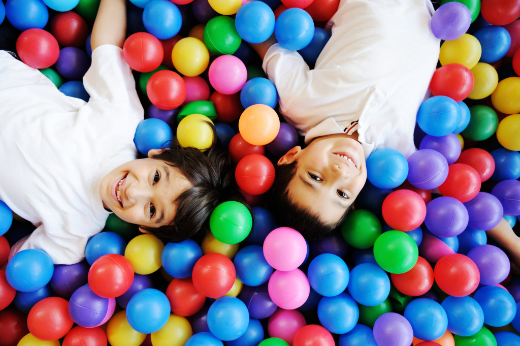 2 boys in colorful balls